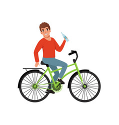 young man riding bicycle and holding bottle of vector image