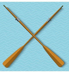 Two wooden oars on wavy background vector image
