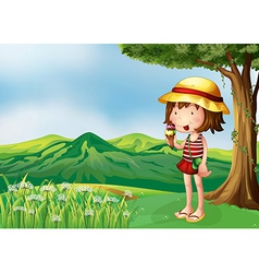A girl eating an icecream at the top of the hills vector