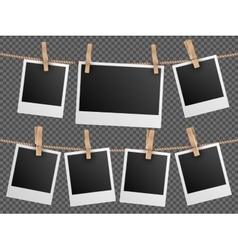 Retro photo frames hanging on rope isolated vector image