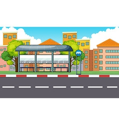 City scene with bus stop and buildings vector image