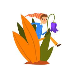 little boy in a pointed striped hat walking in vector image