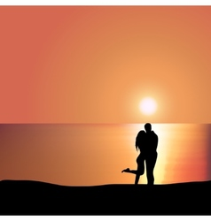 Loving couple on the seashore at sunset vector image