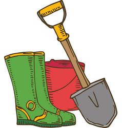 Shovel gumboots and bucket vector