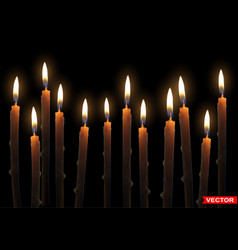 Realistic burning wax candles with flame vector