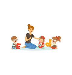 Group preschool kids and teacher sit on carpet vector