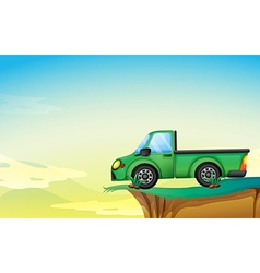 A green cargo truck at the cliff vector