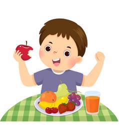 Little boy eating red apple vector