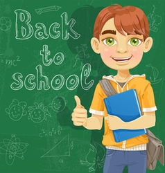 Teenage boy with a textbook near blackboard vector