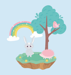cute little rabbit and hedgehog bird in tree and vector image