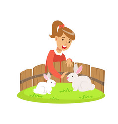 smiling little girl petting two white rabbits in a vector image vector image