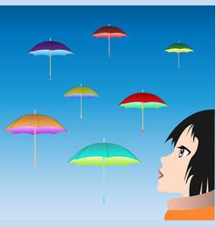 girl watching floating umbrellas vector image