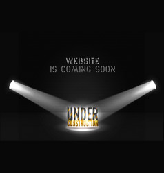 Under construction 3d text in spotlights on dark vector
