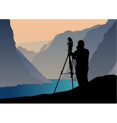 photographer shooting at sunset vector image vector image