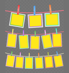 photo multicolored frames on rope with clothespins vector image