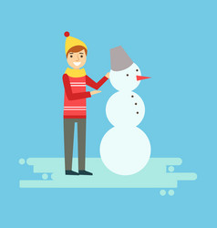 smiling boy making a snowman winter activity vector image