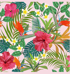 Tropical leaves and flowers seamless pattern vector