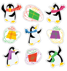 Dancing xmas penguins in a bright scarves and vector