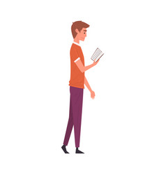 young man in casual clothes standing and reading vector image