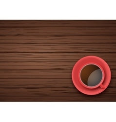 Red Cup of coffee or tea on the table dark wood vector