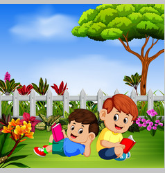 two children reading book in the yard vector image