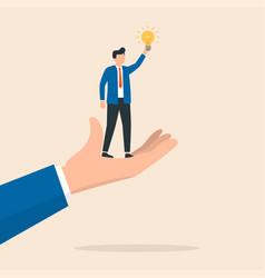 businessman holds a light bulb as a symbol vector image