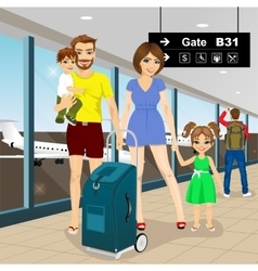 Happy family with suitcase standiing in airport vector image