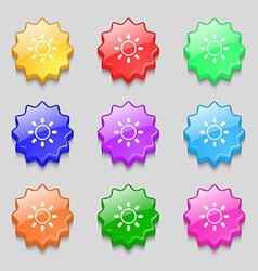 Brightness icon sign symbol on nine wavy colourful vector