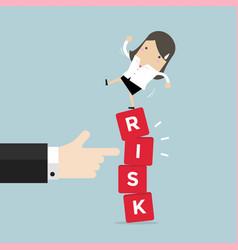 Businesswoman standing on shaky risk blocks vector