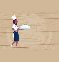 female african american chef cook holding tray vector image