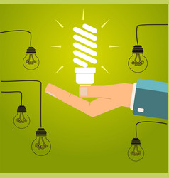 hand holding a bright energy saving light bulb vector image vector image