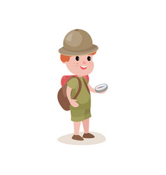 Young explorer with compass in hands and backpack vector