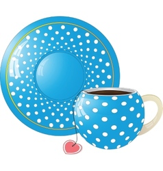 Blue with white dots Cup and saucer vector