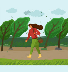 Windy weather woman walking in park through vector