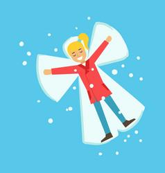 happy girl having fun while making snow angel vector image