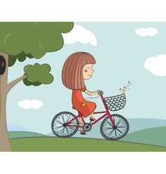 Girl riding a bike vector
