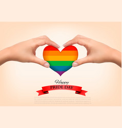 rainbow heart shaped in hands gay pride concept vector image