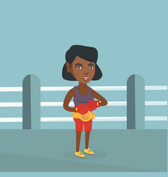 Young african-american confident boxer in the ring vector
