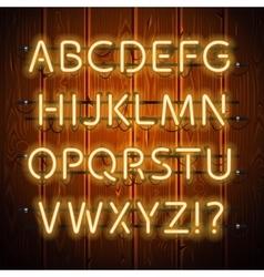Glowing neon alphabet on wooden background vector