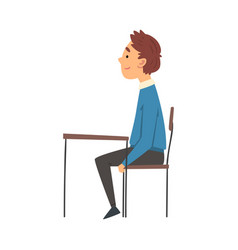 Cute boy sitting at desk in classroom and vector