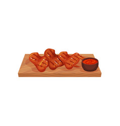 grilled chicken wings served on a wooden board vector image