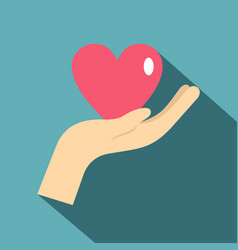 Hand holding a pink heart icon flat style vector