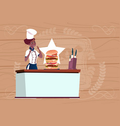 Female african american chef cooking big burger vector
