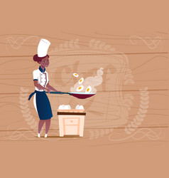 female african american chef cook frying eggs vector image