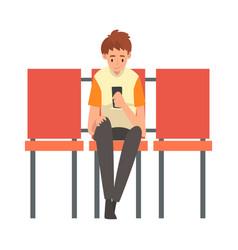 teen boy waiting at airport terminal for flight vector image