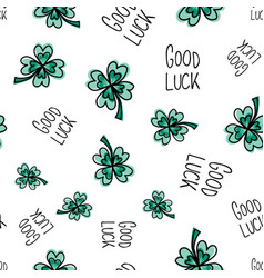 good luck hand drawn lettering and clover leaves vector image