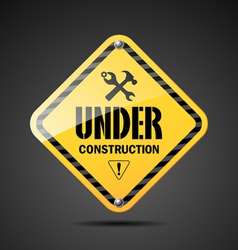 Under construction sign on black background vector image vector image