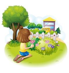 A girl at the garden vector image