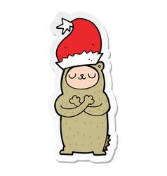 sticker of a cartoon bear wearing christmas hat vector image