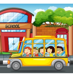 Children riding on yellow bus in town vector